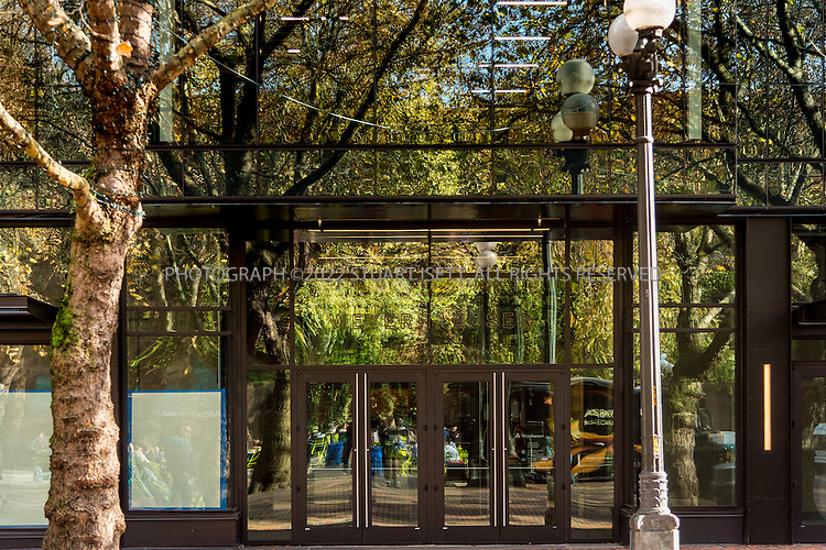 11/4/2016-- Seattle, WA, USA<br /> <br /> Weyerhaeuser&rsquo;s new Seattle headquarters in Pioneer Square, designed by architect Bill LaPatra, a partner at Mithun Architects, a firm well-known for its emphasis on sustainability.<br /> <br /> Here: View of main entrance,<br /> <br /> The building is unusual, because it is almost self-effacing, with the front door opening onto a park-courtyard area, with the building almost hidden behind a line of mature trees. Despite its quiet appearance, this is headquarters for Weyerhaeuser, a major corporate employer.<br /> <br /> Photograph by Stuart Isett. &copy;2016 Stuart Isett. All rights reserved.