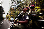 A Kabil soldier, named of the special forces unit, patrols the Pan-American Highway (CA 1) to Antigua, Guatemala, on April 13, 2012. Soldiers and police work together at checkpoints stopping random cars.