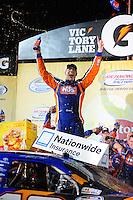 May 1, 2009; Richmond, VA, USA; NASCAR Nationwide Series driver Kyle Busch celebrates after winning the Lipton Tea 250 at the Richmond International Raceway. Mandatory Credit: Mark J. Rebilas-