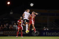 Portland Thorns forward Christine Sinclair (12) goes up for a header with Western New York Flash midfielder Angela Salem (6). The Portland Thorns defeated the Western New York Flash 2-0 during the National Women's Soccer League (NWSL) finals at Sahlen's Stadium in Rochester, NY, on August 31, 2013.