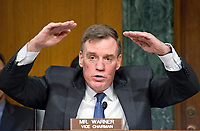 """United States Senator Mark Warner (Democrat of Virginia), Vice Chairman, US Senate Select Committee on Intelligence questions the witnesses during the open hearing titled """"Disinformation: A Primer in Russian Active Measures and Influence Campaigns"""" on Capitol Hill in Washington, DC on Thursday, March 30, 2017. Photo Credit: Ron Sachs/CNP/AdMedia"""