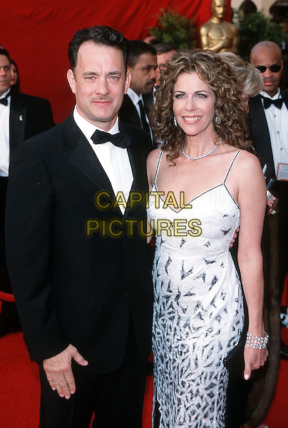 RITA WILSON & TOM HANKS..Oscars, 2001..Ref: 10304..half length, half-length, white dress, spaghetti straps..www.capitalpictures.com..sales@capitalpictures.com..©Capital Pictures