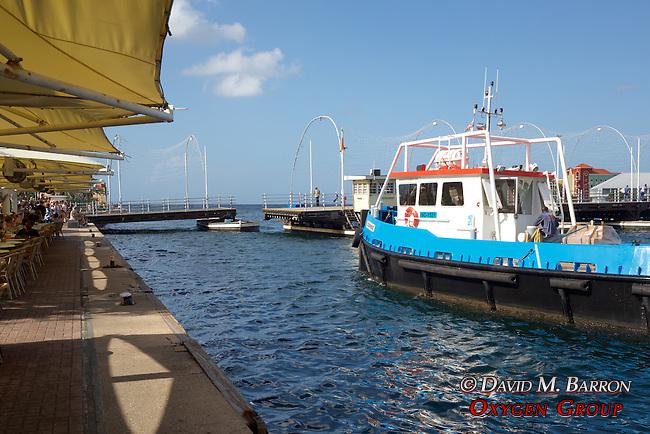 Tug Boat Passing Through Floating Bridge