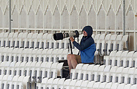 Photographer wraps up against the biting wind during Nottinghamshire CCC vs Essex CCC, Specsavers County Championship Division 1 Cricket at Trent Bridge on 1st July 2019