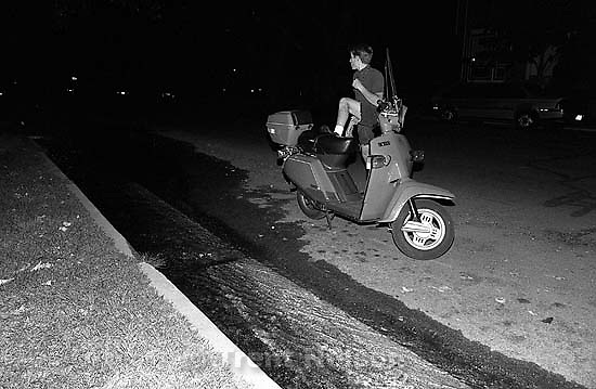 Bob Walter kicks over a scooter<br />