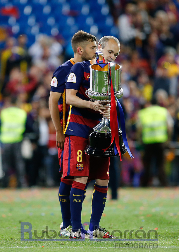 FC Barcelona´s  midfielder Andres Iniesta with the trophy after winning the Copa del Rey