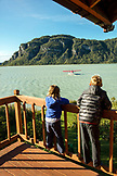 USA, Alaska, Redoubt Bay, Big River Lake, two kids watching a float plane depart from Redoubt Bay