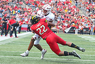 College Park, MD - September 15, 2018: Maryland Terrapins linebacker Isaiah Davis (22) tackles Temple Owls wide receiver Branden Mack (88)  during the game between Temple and Maryland at  Capital One Field at Maryland Stadium in College Park, MD.  (Photo by Elliott Brown/Media Images International)
