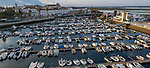 Boats at mooring in harbour marina in centre of city of Faro, Algarve, Portugal, Southern Europe early morning