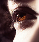 Closeup of woman brown eye in sunlight