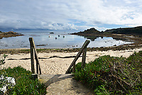 Steps leading down to the beach at Old Town Bay, St Mary's, Isles of Scilly, UK