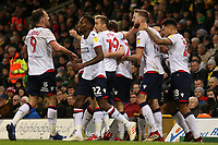 Bolton Wanderers' Mark Beevers is mobbed after making it 2-2<br /> <br /> Photographer David Shipman/CameraSport<br /> <br /> The EFL Sky Bet Championship - Norwich City v Bolton Wanderers - Saturday 8th December 2018 - Carrow Road - Norwich<br /> <br /> World Copyright &copy; 2018 CameraSport. All rights reserved. 43 Linden Ave. Countesthorpe. Leicester. England. LE8 5PG - Tel: +44 (0) 116 277 4147 - admin@camerasport.com - www.camerasport.com