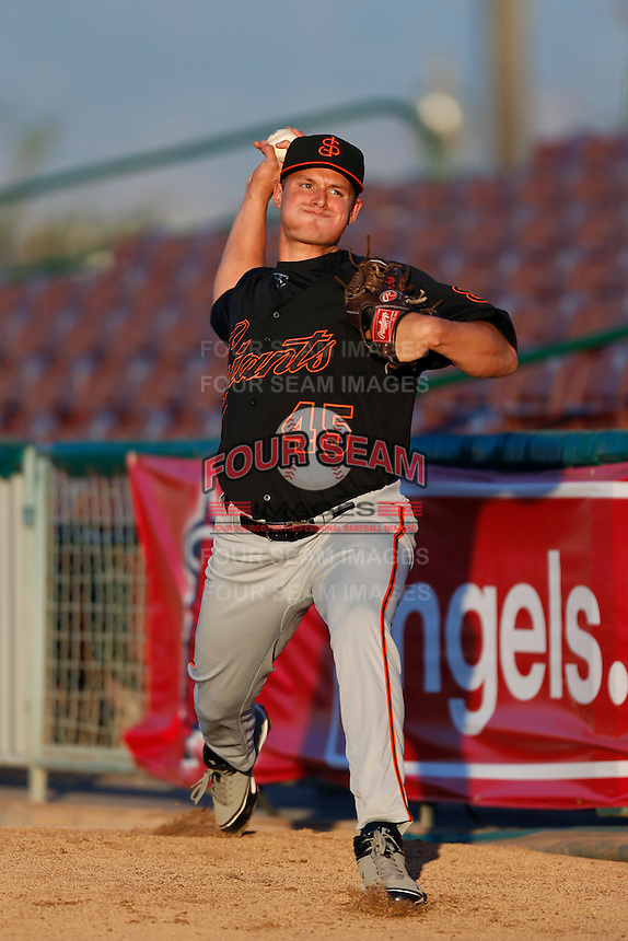 Kyle Crick #45 of the San Jose Giants throws in the bullpen before pitching against the Inland Empire 66'ers on April 18, 2013 at San Manuel Stadium in San Bernardino, California. (Larry Goren/Four Seam Images)