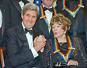 United States Secretary of State John F. Kerry and Shirley MacLaine shake hands as they pose for a group photo with the other four recipients of the 2013 Kennedy Center Honors  following a dinner hosted by Kerry at the U.S. Department of State in Washington, D.C. on Saturday, December 1, 2013.  The 2013 honorees are opera singer Martina Arroyo; pianist, keyboardist, bandleader and composer Herbie Hancock; pianist, singer and songwriter Billy Joel; actress Shirley MacLaine; and musician and songwriter Carlos Santana.<br /> Credit: Ron Sachs / CNP