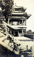BNPS.co.uk (01202 558833)<br /> Pic: ClevedonAuctionRooms/BNPS<br /> <br /> Temple building in China.<br /> <br /> Rev Francis John Griffith travelled as a Missionary aroud Outer Mongolia in the 1920's.<br /> <br /> A fascinating collection of early 20th century photos of Mongolia and China which were taken by a British vicar doing missionary work have been unearthed after 97 years.<br /> <br /> Through his famine relief work Reverend Francis John Griffith was able to get a remarkable insight into the lives of the native population and their nomadic existence.<br /> <br /> His encounters were captured using a handheld camera that he carried with him at all times.<br /> <br /> In one image a family goes about its business outside the hut that is their home, while another image is of a man riding a camel which was the typical method of transport.<br /> <br /> Revd Griffith was able to get native elders to sit for him in portraits and there are intimate snaps of women and children wearing elaborate native headdresses.<br /> <br /> As well as the people, Revd Griffith took an interest in the surroundings and photographed temples and prominent buildings in addition to the vast, desert landscape.