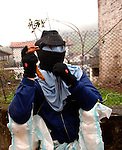 A person dressed up in costume performs during the celebration of an ancient traditional carnival on January, 31st 2006 at the village of Zubieta, Basque Country. Joaldun groups take part in the carnival at the villages of Ituren and Zubieta carrying sheep furs and big cowbells on their backs to wake up the earth, looking for a good new year, a good harvest and to keep away the bad spirits.. Bostok Photo: Ander Gillenea