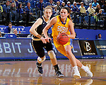 BROOKINGS, SD - DECEMBER 11:  Kerri Young #10 from South Dakota State University drives against Hannah Schaible #20 from George Washington during their game Sunday afternoon at Frost Arena in Brookings. (Photo by Dave Eggen/Inertia)