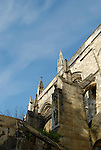 Looking upwards at buttresses on Winchester Cathedral