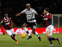 Calcio, Serie A:  Bologna vs Juventus. Bologna, stadio Renato Dall'Ara, 19 febbraio 2016. <br /> Juventus&rsquo; Paul Pogba, center, is challenged by Bologna&rsquo;s Luca Rizzo, right, during the Italian Serie A football match between Bologna and Juventus at Bologna's Renato Dall'Ara stadium, 19 February 2016.<br /> UPDATE IMAGES PRESS/Isabella Bonotto