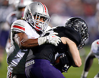 Ohio State Buckeyes cornerback Bradley Roby (1) brings down Northwestern Wildcats quarterback Zack Oliver (10) during their game at Ryan Field in Evanston, IL on October 5, 2013. (Columbus Dispatch photo by Brooke LaValley)