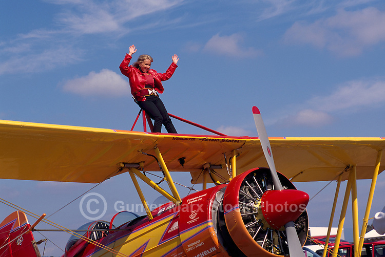 "Wingwalker (Teresa Stokes) wingwalking on Gene Soucy's Grumman Ag Cat Biplane ""Showcat"" - at Abbotsford International Airshow, BC, British Columbia, Canada"