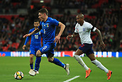 27th March 2018, Wembley Stadium, London, England; International Football Friendly, England versus Italy; Andrea Belotti of Italy takes on Ashley Young of England