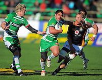 Manawatu's Frankie Bryant fends off Mark Reddish as James Oliver runs in support. ITM Cup rugby - Manawatu Turbos v Wellington Lions at FMG Stadium, Palmerston North, New Zealand on Saturday, 4 September 2010. Photo: Dave Lintott/lintottphoto.co.nz
