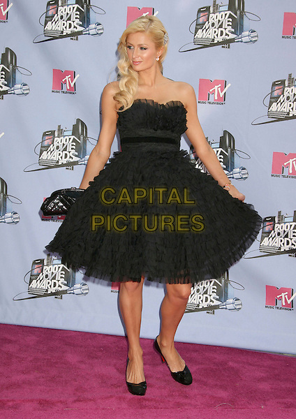PARIS HILTON .2007 MTV Movie Awards held at the Gibson Amphitheater, Universal City, California, USA..June 3rd, 2007.full length dress black strapless sheer chiffon ruffles christian louboutin shoes hair clip clutch purse bag .CAP/ADM/RE.©Russ Elliot/AdMedia/Capital Pictures *** Local Caption *** ...