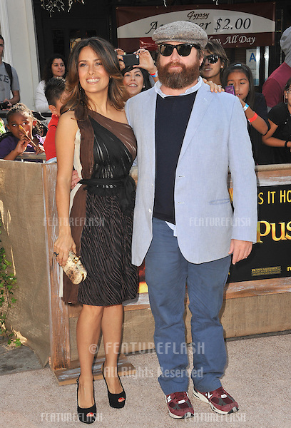 "Salma Hayek & Zach Galifianakis at the Los Angeles premiere of their new movie ""Puss in Boots"" at the Regency Village Theatre, Westwood..October 23, 2011  Los Angeles, CA.Picture: Paul Smith / Featureflash"