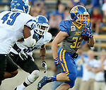 BROOKINGS, SD - OCTOBER 10:  Kyle Paris #32 from South Dakota State scampers past Antonio Broadus #49 and Marcus Gray #38 from Indiana State in the first half of their game Saturday night at Coughlin Alumni Stadium. (Photo by Dave Eggen/Inertia)