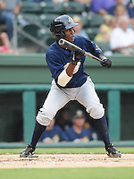 Infielder Jose Toussen (9) of the Charleston RiverDogs, Class A affiliate of the New York Yankees, in a game against the Greenville Drive on July 31, 2011, at Fluor Field at the West End in Greenville, South Carolina. (Tom Priddy/Four Seam Images)
