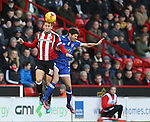 Billy Sharp of Sheffield Utd and Ryan Flynn of Oldham during the English League One match at Bramall Lane Stadium, Sheffield. Picture date: December 26th, 2016. Pic Simon Bellis/Sportimage