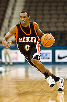 January 9, 2009:     Mercer guard James Florence (0) brings the ball down court in Atlantic Sun Conference action between the Jacksonville Dolphins and the Mercer Bears at Veterans Memorial Arena in Jacksonville, Florida.  Jacksonville defeated Mercer 80-59.
