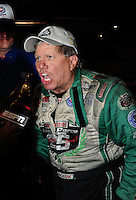 Nov 14, 2010; Pomona, CA, USA; NHRA funny car driver John Force is interviewed after winning the Auto Club Finals at Auto Club Raceway at Pomona. Mandatory Credit: Mark J. Rebilas-
