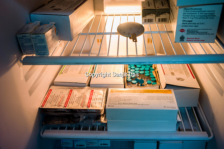 Vaccines and other medicines are seen in a fridge at the government health centre in Tharmapuram in North Kilinochchi, Sri Lanka.  Photo: Sanjit Das/Panos