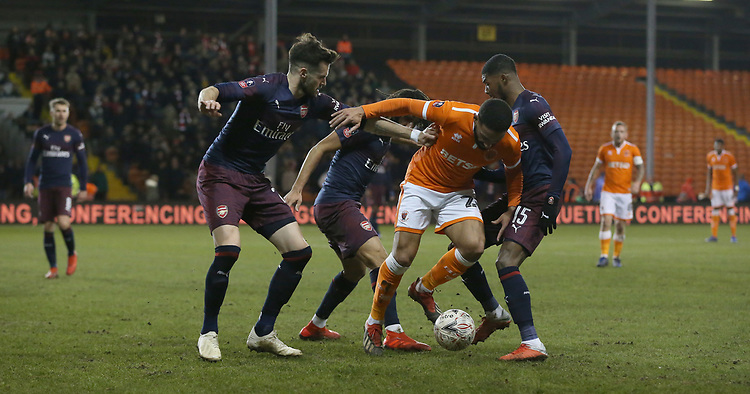 Blackpool's Liam Feeney battles with (L to R) Arsenal's Carl Jenkinson. Mohamed Elneny and Ainsley Maitland-Niles<br /> <br /> Photographer Stephen White/CameraSport<br /> <br /> Emirates FA Cup Third Round - Blackpool v Arsenal - Saturday 5th January 2019 - Bloomfield Road - Blackpool<br />  <br /> World Copyright &copy; 2019 CameraSport. All rights reserved. 43 Linden Ave. Countesthorpe. Leicester. England. LE8 5PG - Tel: +44 (0) 116 277 4147 - admin@camerasport.com - www.camerasport.com