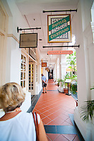Tourists and Guests Shopping at Raffles Courtyard, Singapore. Raffles hotel is the most luxurious, up market hotel in Singapore. With Raffles City shopping mall  home to shops such as Rolex and boasting no less that 12 different restaurants and bars, guests barely need leave the hotel. It is a popular place for tourists to shop and or enjoy afternoon tea if your purse strings can stretch a little.