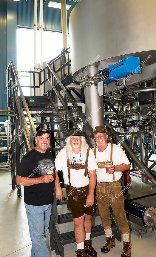 Wisconsin Brewing Company president, Carl Nolen, celebrates the creation of Depth Charge Scotch Ale by brewmasters Kirby Nelson and Mike McGuire (L-R) on Sunday, July 12, 2015, in Verona, Wisconsin.