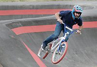 NWA Democrat-Gazette/DAVID GOTTSCHALK Jason Lind, of Springdale, takes a practice run Tuesday, October 9, 2018, the pump track at the Runway Bicycle Skills Park at the Jones Center in Springdale. The park will host the Pump Track (bicycling) World Championships sponsored by Red Bull on Saturday, October 13. A pump track is designed so that bikers pump and push on hills and turns to build speed using their upper body and hips instead of pedaling.