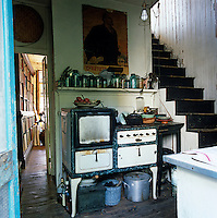 A makeshift kitchen has been created in a back room - originally the cooking facilities would have been outside