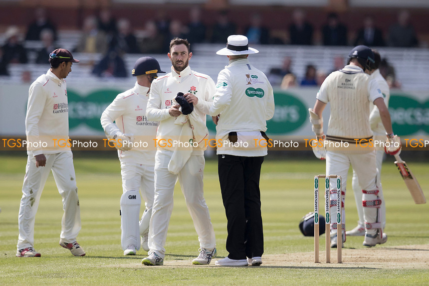Glenn Maxwell of Lancashire CCC takes his cap and jumper from the umpire during Middlesex CCC vs Lancashire CCC, Specsavers County Championship Division 2 Cricket at Lord's Cricket Ground on 11th April 2019