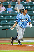 Adrian Ortiz #6 of the Wilmington Blue Rocks follows through on his swing against the Winston-Salem Dash at  BB&T Ballpark August 4, 2010, in Winston-Salem, North Carolina.  Photo by Brian Westerholt / Four Seam Images