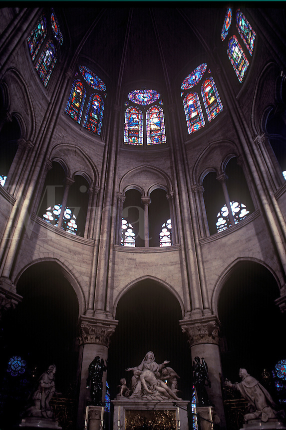 Interior of the Notre Dame Cathedral, featuring Pieta sculpture by Michelangelo.  Paris, France