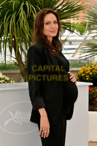 "ANGELINA JOLIE .""The Exchange"" ( formerly titled ""Changeling"" ) photocall at Palais de Festival during the 61st Cannes International Film Festival, Cannes, France. .20th May 2008 .half length black jacket hand on stomach belly pregnant top.CAP/PL.©Phil Loftus/Capital Pictures."