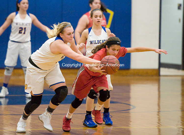 SEYMOUR, CT-011018JS20---Seymour's Kolby Sirowich (1) and Wolcott's Emiah Soto (1) run down a loose ball during their game Wednesday at Seymour High School. <br />  Jim Shannon Republican-American