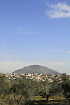 Israel, Lower Galilee, Arab village Iksal, Mount Tabor is in the background