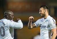 Adebayo Akinfenwa & Max Muller of Wycombe Wanderers celebrate at full time during the The Checkatrade Trophy  Quarter Final match between Mansfield Town and Wycombe Wanderers at the One Call Stadium, Mansfield, England on 24 January 2017. Photo by Andy Rowland.