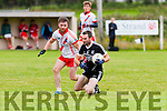 Hairy Moment<br /> -------------------<br /> Darren Dineen,Ardfert holds possession while Ciaran O Coileain,An Gaeltacht gets close when the sides met in Ardfert GAA ground last Saturday evening.