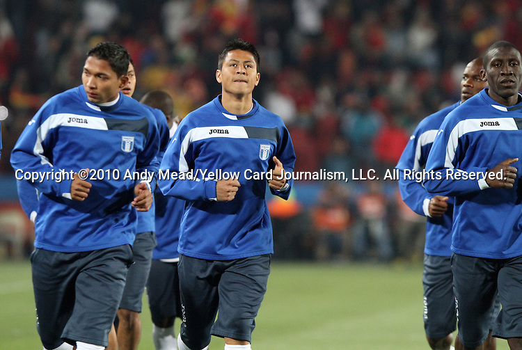 21 JUN 2010: Roger Espinoza (HON) (center) and teammates warm up before the game. The Spain National Team defeated the Honduras National Team 2-0 at Ellis Park Stadium in Johannesburg, South Africa in a 2010 FIFA World Cup Group H match.