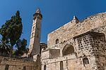 The minaret of the Mosque of Omar, located next to the Church of the Holy Sepulchre. at right, in the Christian Quarter of the Old City of Jerusalem.  The Old City of Jerusalem and its Walls is a UNESCO World Heritage Site
